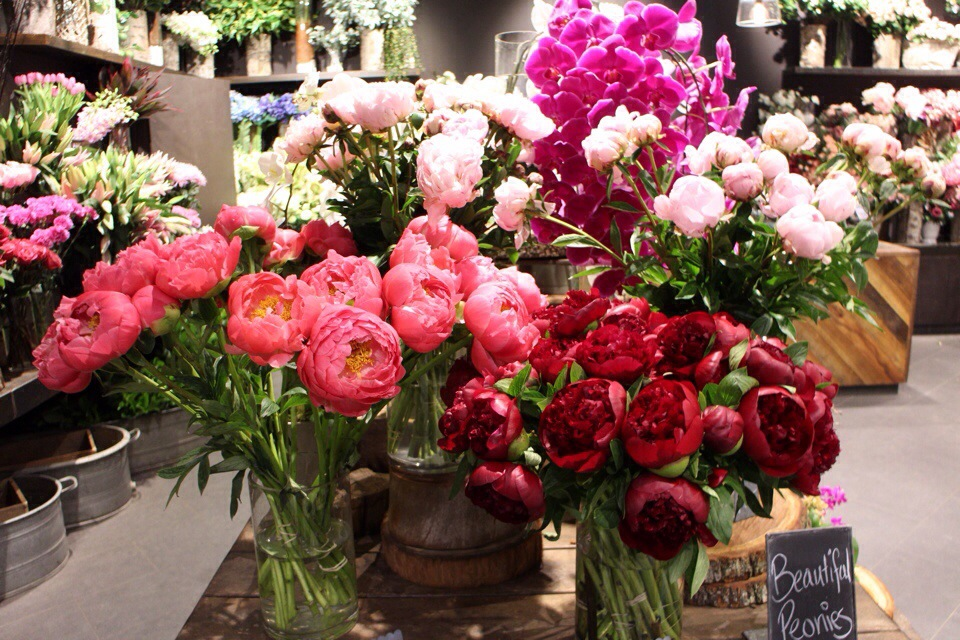 beautiful flower shop with peony and rose